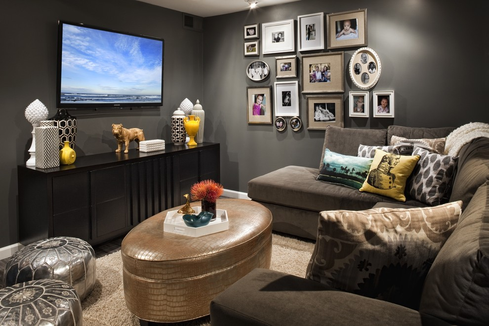 Family room - transitional family room idea in Los Angeles with gray walls and a wall-mounted tv