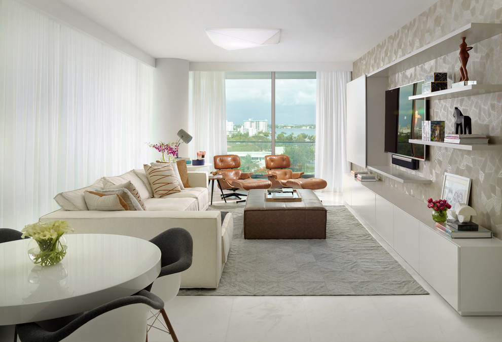 Example of a small trendy open concept family room design in Miami with white walls and a media wall