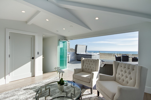 Inspiration for a beach style open concept porcelain floor and brown floor family room remodel in Orange County with gray walls, no fireplace and no tv