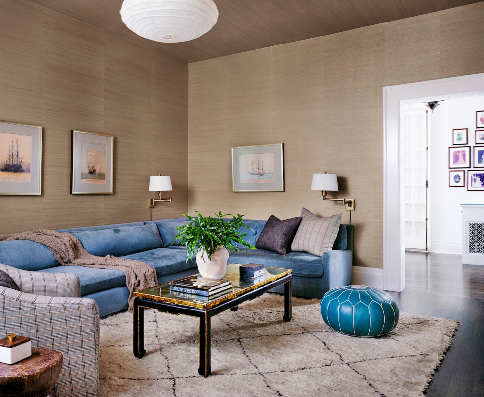 Example of a mid-sized transitional enclosed dark wood floor, brown floor, wallpaper ceiling and wallpaper family room design in Austin with beige walls and no fireplace