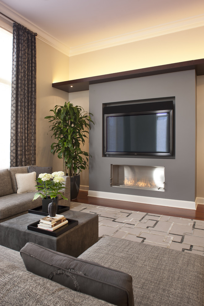 Trendy dark wood floor family room photo in Chicago with beige walls, a ribbon fireplace and a wall-mounted tv