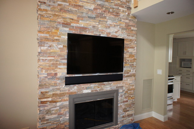 Over Fireplace Led Tv Installation With Sound Bar On Brick