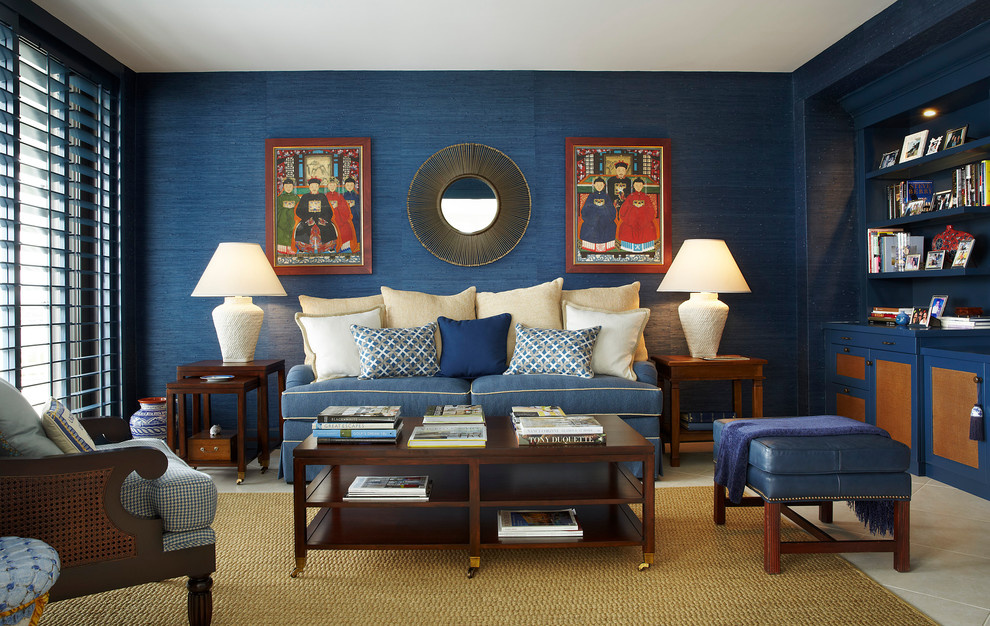 Example of a mid-sized transitional open concept beige floor family room design in Miami with blue walls and no tv