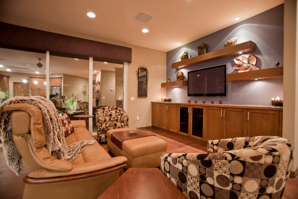 Inspiration for a small contemporary open concept medium tone wood floor and brown floor family room remodel in Other with a wall-mounted tv, multicolored walls and no fireplace