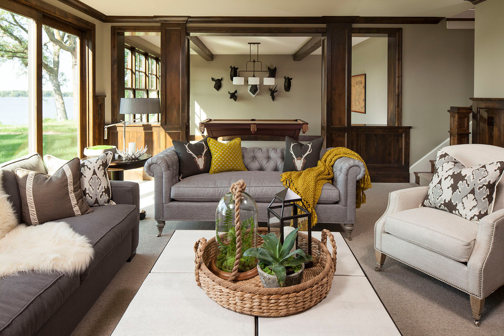 Example of a classic carpeted family room design in Minneapolis with beige walls