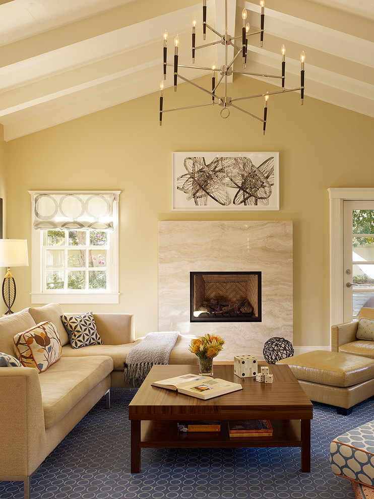 Example of a transitional family room design in San Francisco with beige walls, a standard fireplace and a stone fireplace