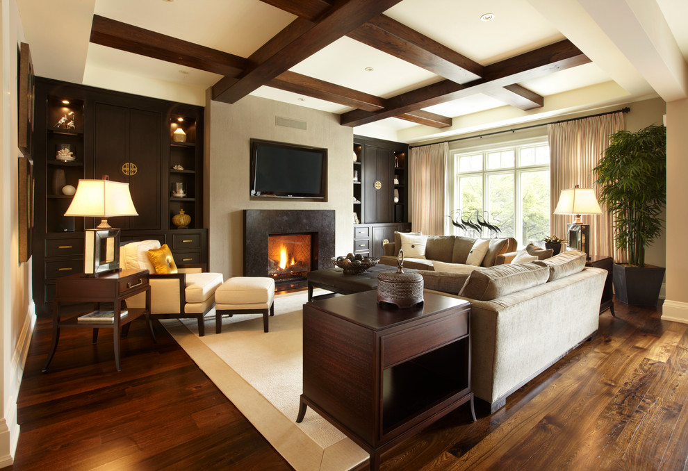 Example of a large transitional open concept medium tone wood floor family room design in Toronto with beige walls, a standard fireplace, a stone fireplace and a wall-mounted tv