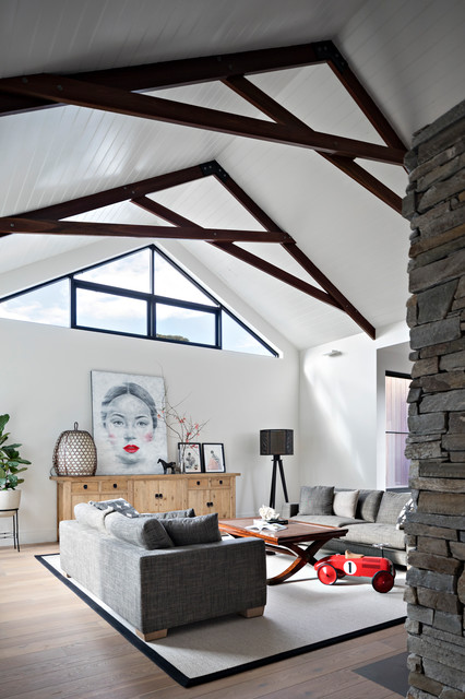 Family room - contemporary medium tone wood floor and brown floor family room idea in Melbourne with white walls