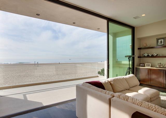 Peninsula Beachfront Custom beach-style-family-room