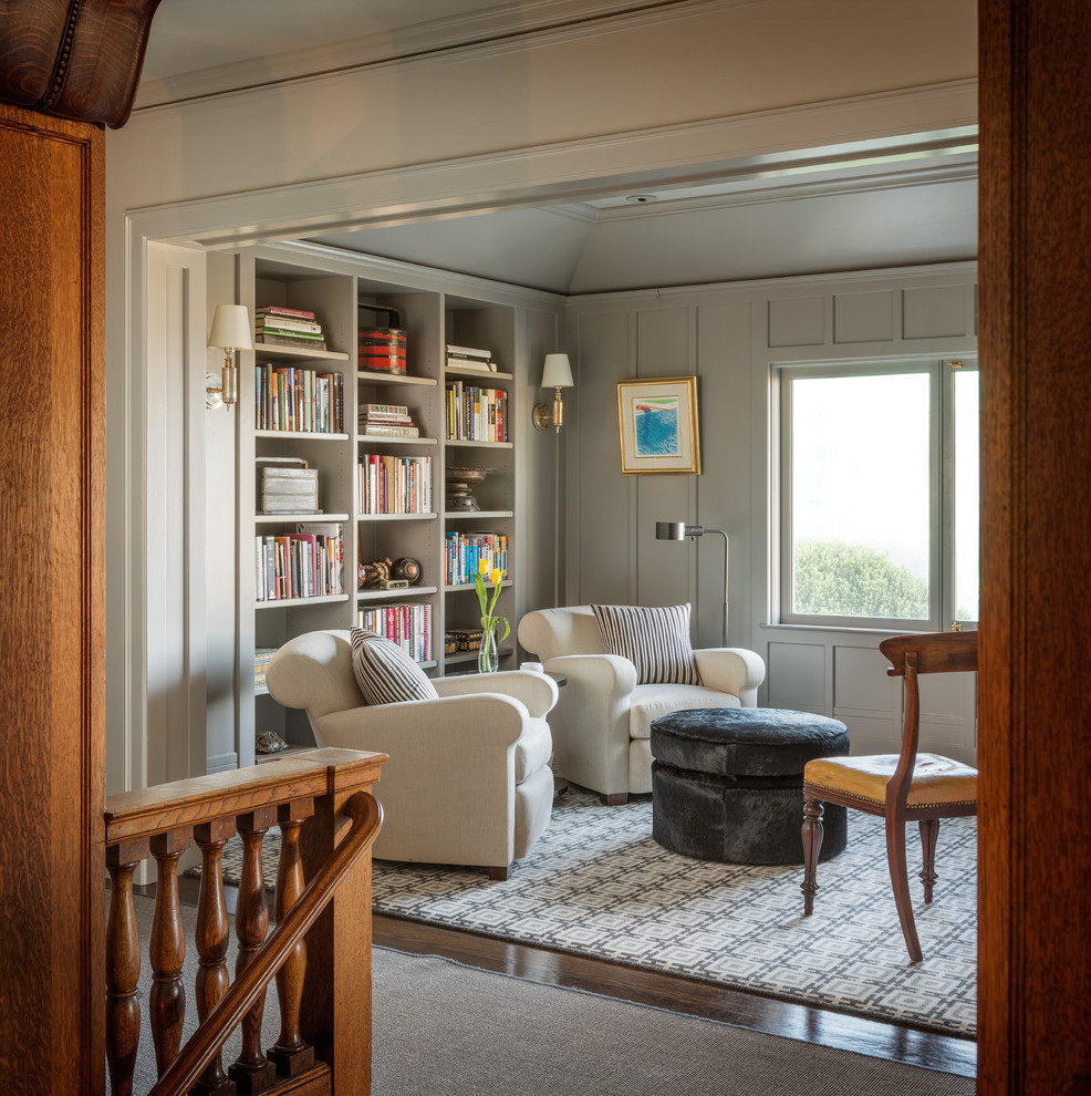 Example of a transitional dark wood floor family room library design in San Francisco with gray walls