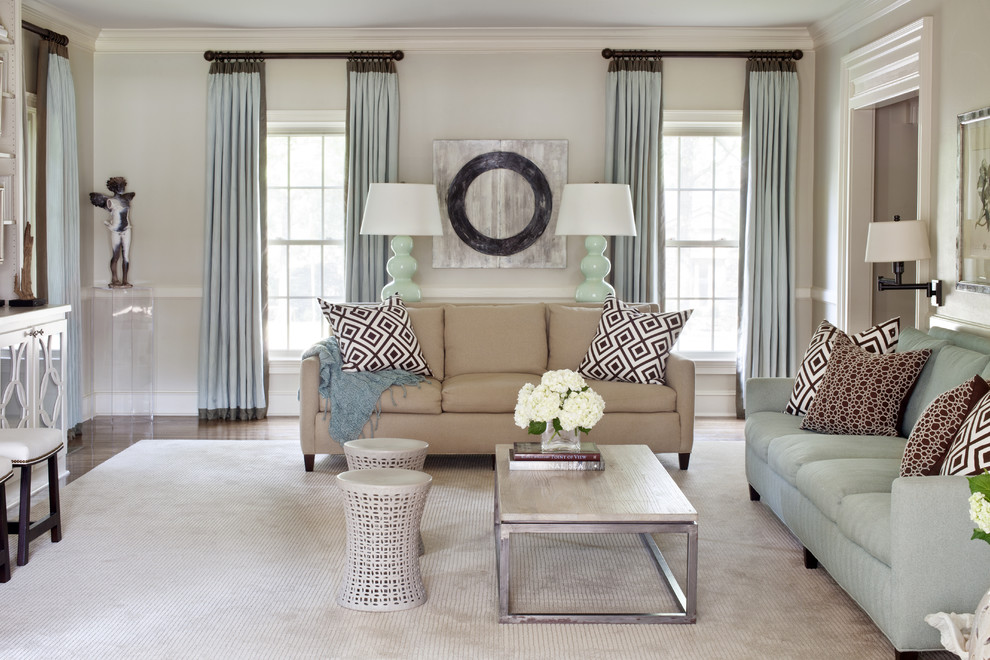 Inspiration for a mid-sized transitional open concept carpeted family room remodel in Little Rock with beige walls