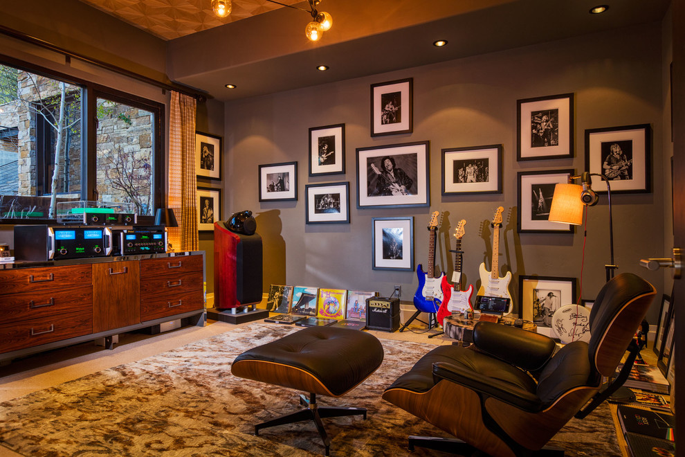 Family room - rustic enclosed carpeted family room idea in Denver with a music area and gray walls