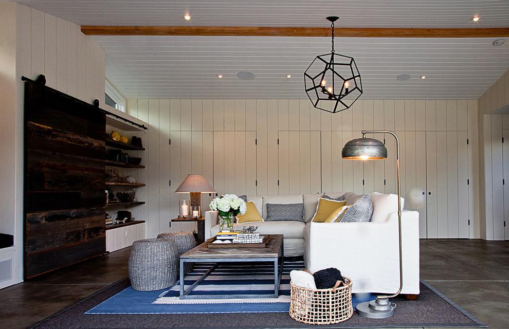 Family room - contemporary concrete floor family room idea in Los Angeles