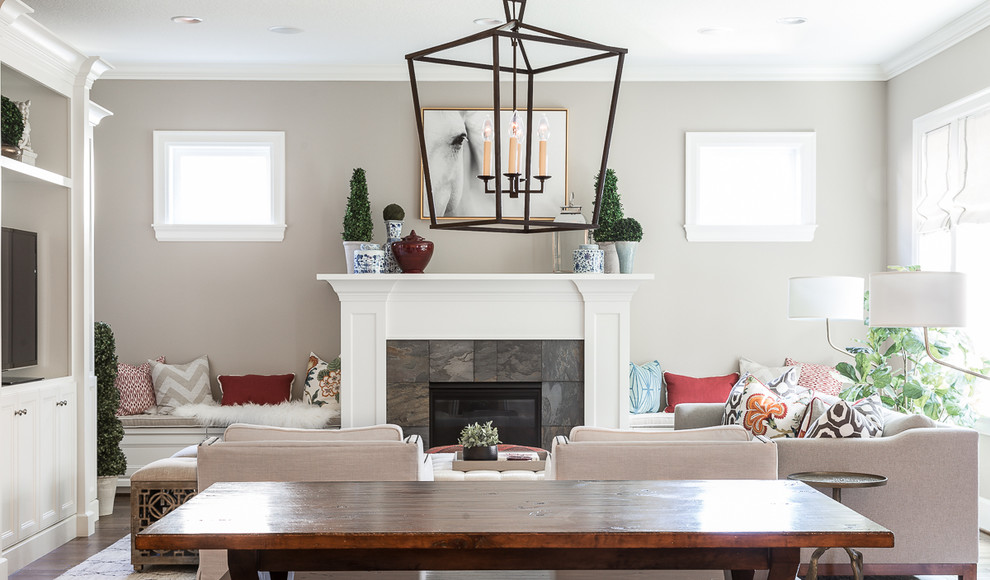 Inspiration for a mid-sized transitional open concept dark wood floor and brown floor family room remodel in Portland with beige walls, a standard fireplace, a tile fireplace and a media wall