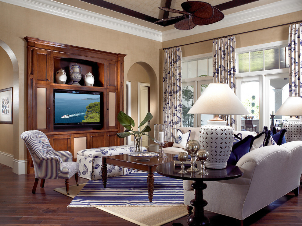 Inspiration for a timeless open concept dark wood floor and brown floor family room remodel in Miami with beige walls and a media wall