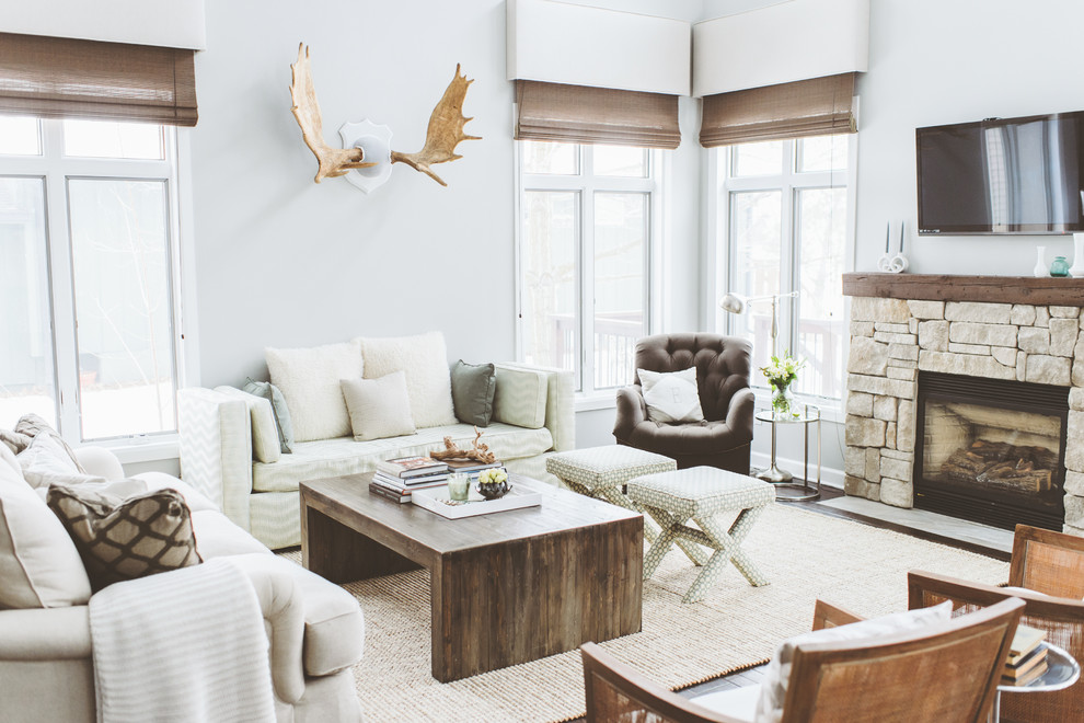Inspiration for a coastal family room remodel in Minneapolis with a stone fireplace