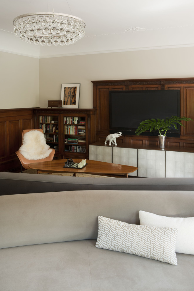 Example of a minimalist family room design in New York with beige walls and a wall-mounted tv