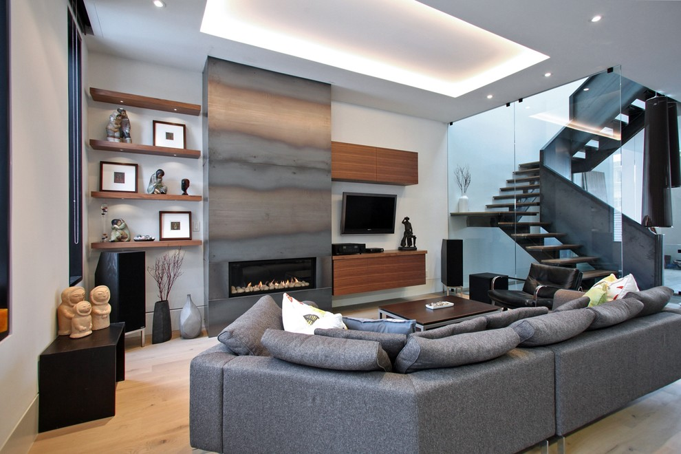 Trendy open concept light wood floor family room photo in Toronto with a ribbon fireplace, a metal fireplace and a wall-mounted tv