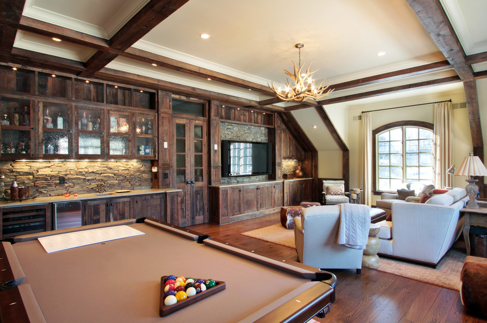 Inspiration for a rustic medium tone wood floor game room remodel in New York with beige walls and a wall-mounted tv