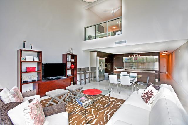 Example of a coastal family room design in Miami