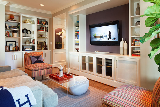 Inspiration for a contemporary medium tone wood floor family room remodel in DC Metro with purple walls and a media wall