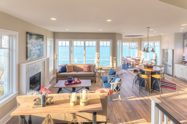 Example of a large coastal open concept family room design in Chicago with a stone fireplace