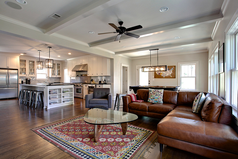Example of a trendy open concept medium tone wood floor family room design in Dallas with gray walls