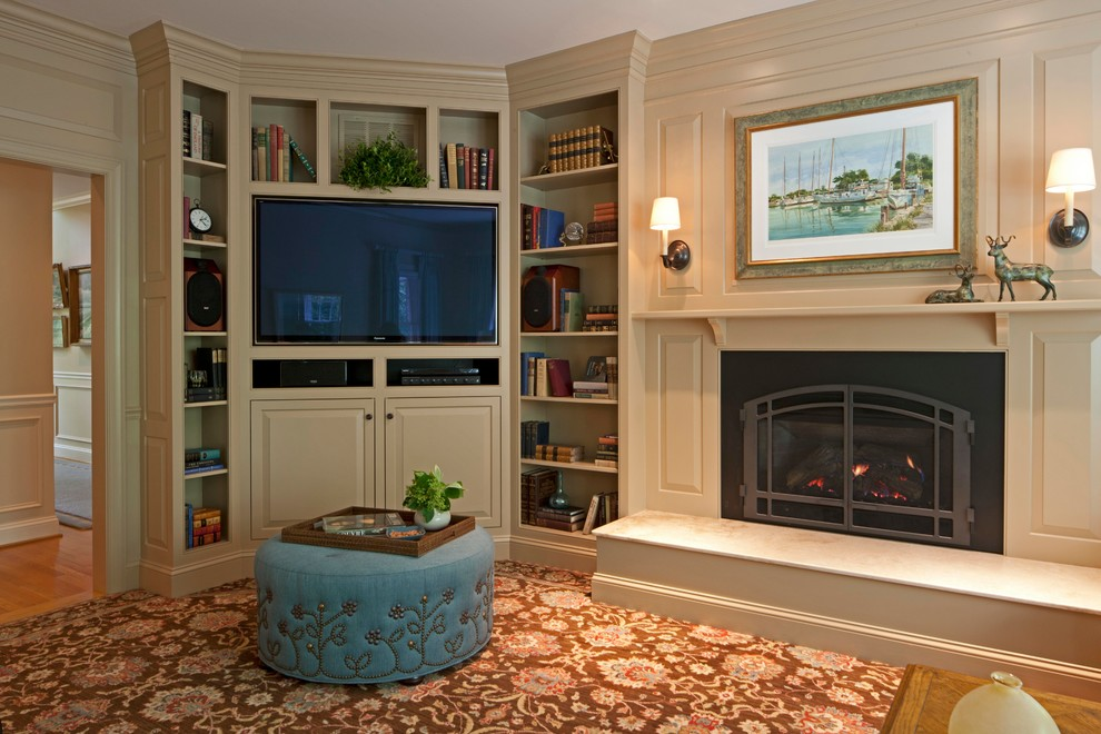 Mid-sized transitional enclosed carpeted and brown floor family room library photo in DC Metro with beige walls, a standard fireplace, a media wall and a metal fireplace