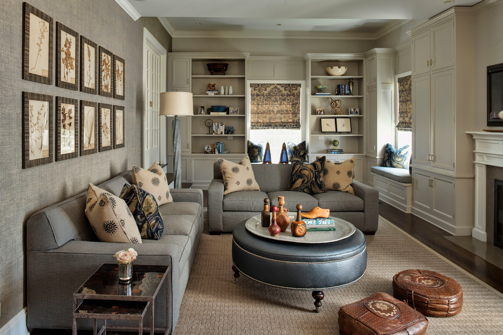 Inspiration for a large timeless enclosed dark wood floor family room remodel in Chicago with gray walls, a standard fireplace and a wall-mounted tv