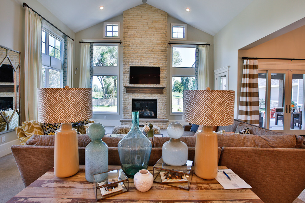 Example of a large transitional open concept carpeted family room design in Salt Lake City with gray walls, a standard fireplace, a stone fireplace and a wall-mounted tv