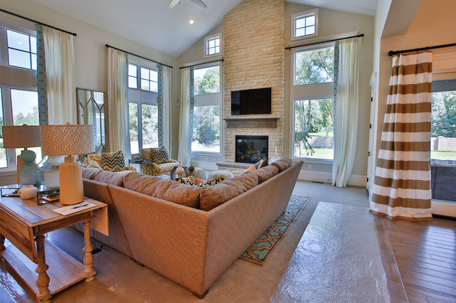 Large transitional open concept carpeted family room photo in Salt Lake City with gray walls, a standard fireplace, a stone fireplace and a wall-mounted tv