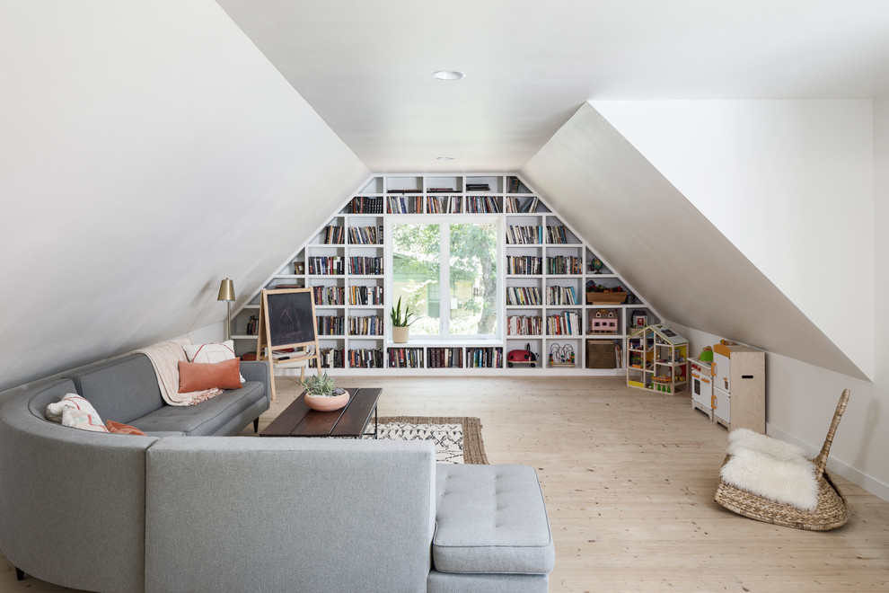 Inspiration for a mid-sized farmhouse open concept light wood floor and beige floor family room library remodel in Austin with white walls and no tv