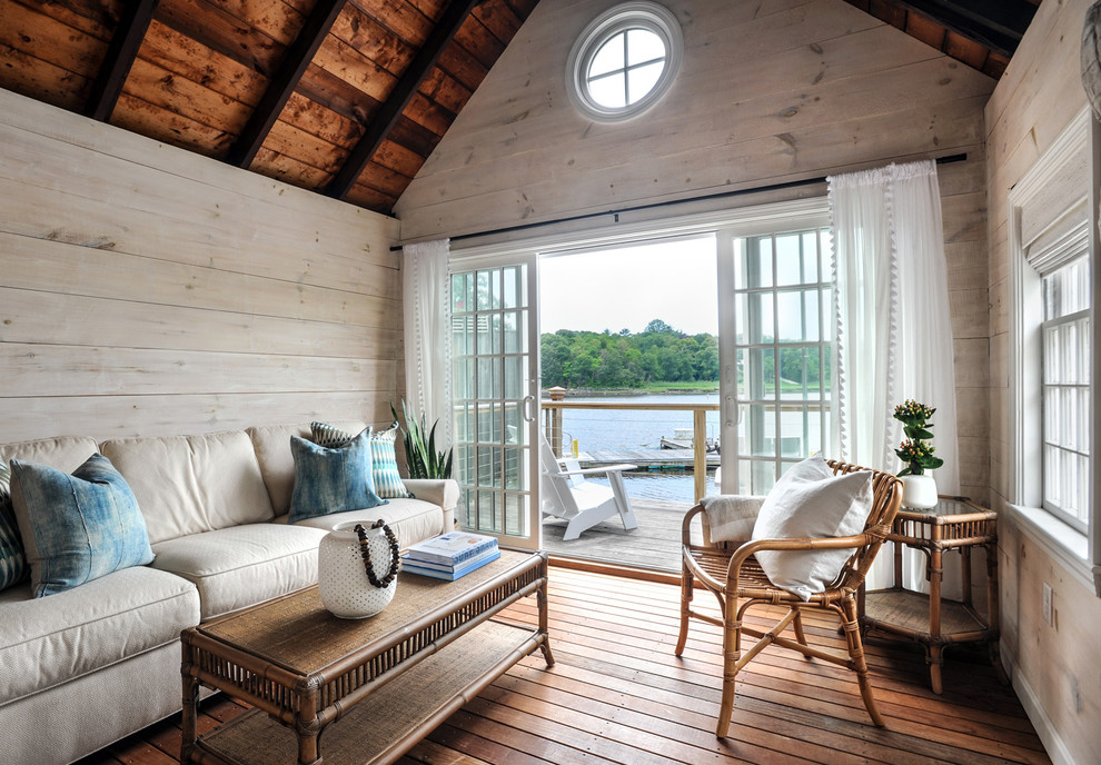 Example of a beach style family room design in Other