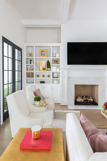 Family room - large transitional open concept porcelain floor family room idea in Houston with white walls, a standard fireplace, a tile fireplace and a wall-mounted tv