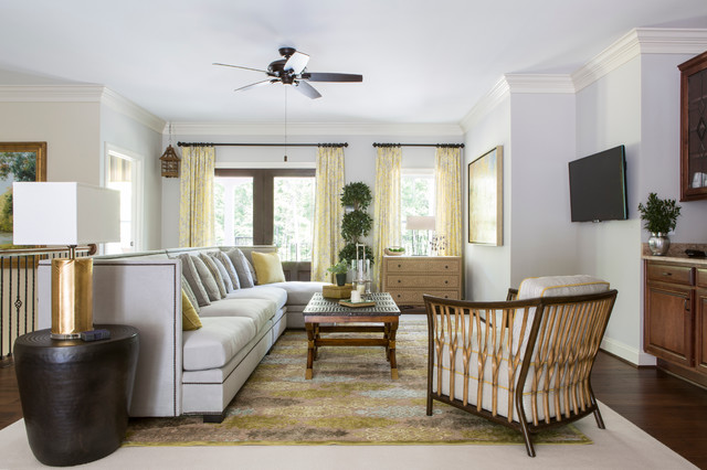 Large transitional open concept medium tone wood floor and brown floor family room photo in DC Metro with gray walls, a wall-mounted tv and no fireplace