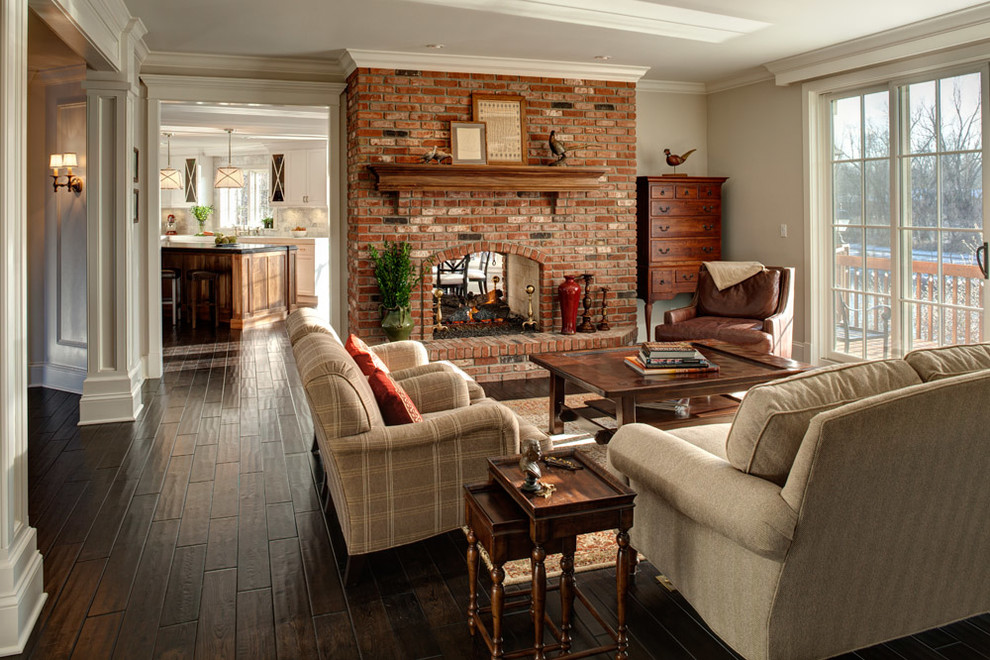 Inspiration for a timeless family room remodel in Chicago with beige walls, a two-sided fireplace and a brick fireplace