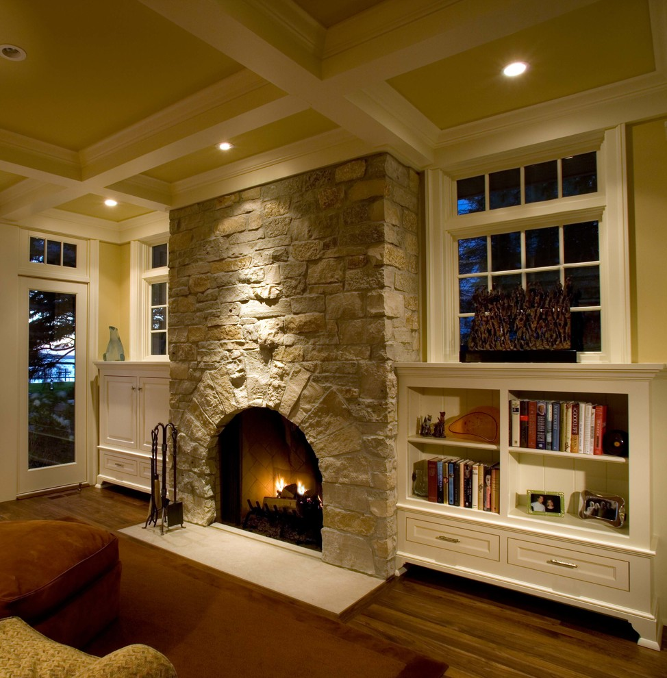 Elegant family room photo in Minneapolis with a stone fireplace