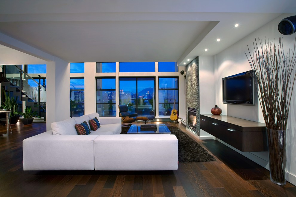 Example of a large trendy open concept dark wood floor family room design in Vancouver with a standard fireplace and a wall-mounted tv