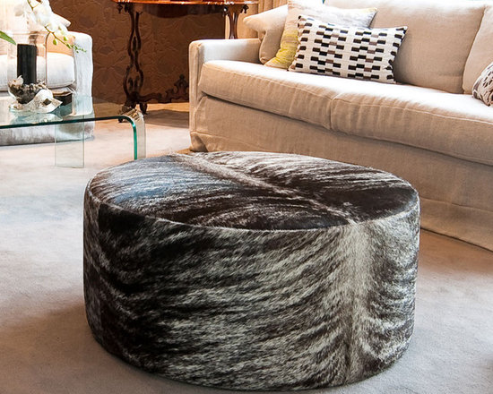 Gorgeous Creatures New Zealand - Round taupe brindle cowhide ottoman - This lovely round cowhide ottoman was made from a gorgeous hide that was the perfect colour for the room. Made to the clients specifications.