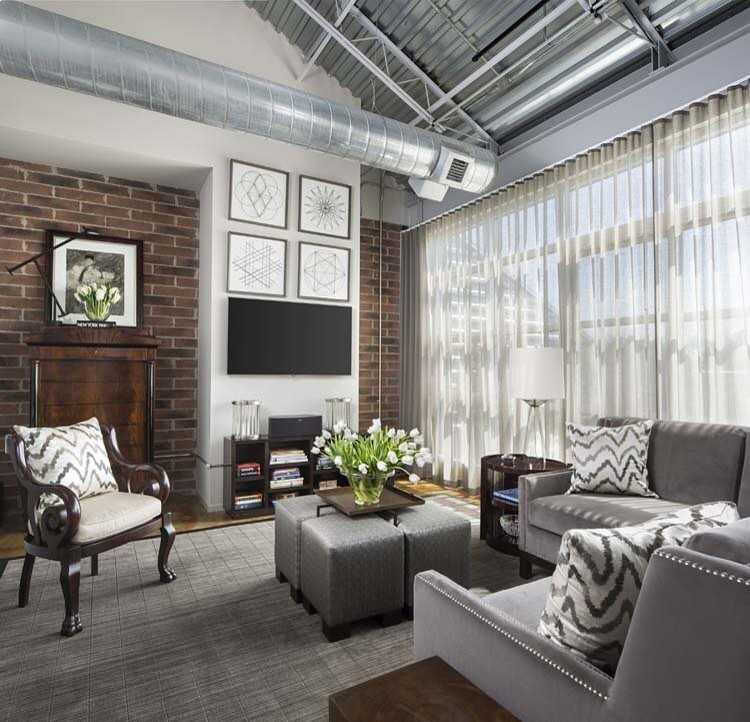 Mid-sized urban open concept carpeted and gray floor family room photo in Detroit with white walls, no fireplace and a wall-mounted tv