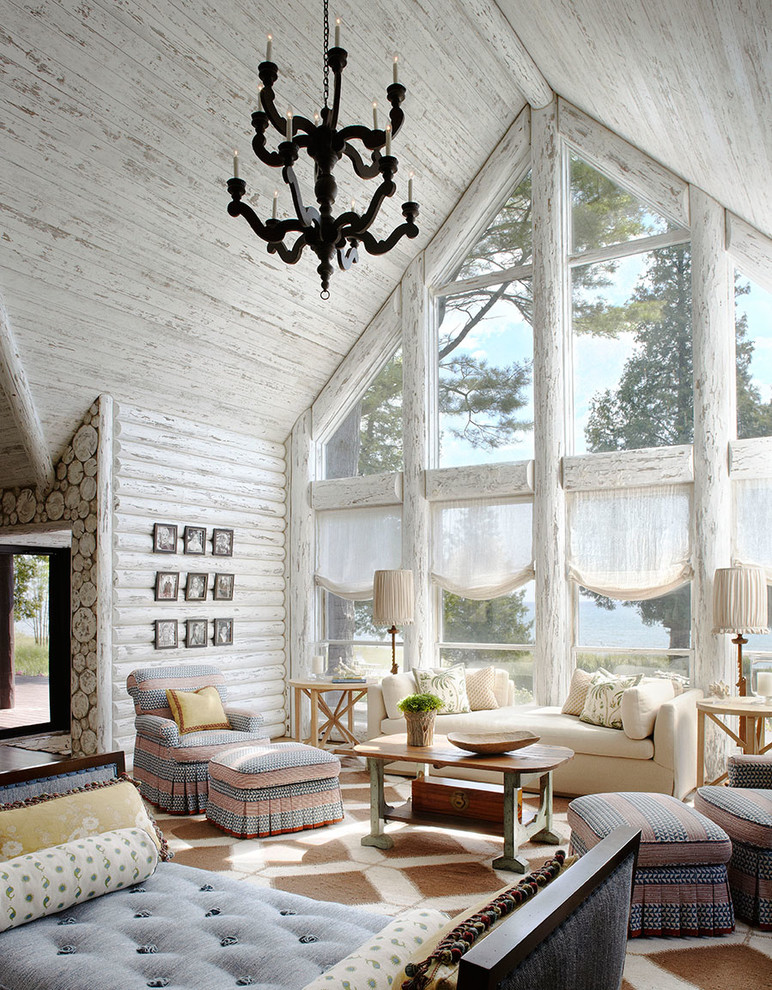 Example of a beach style open concept family room design in Milwaukee with white walls and no tv