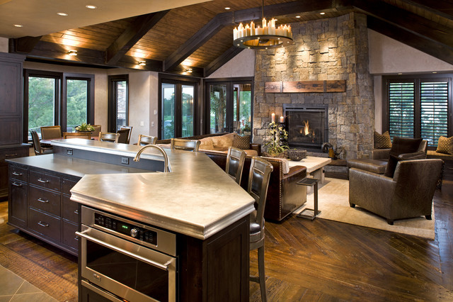 Inspiration For A Rustic Family Room Remodel In Minneapolis With Stone Fireplace