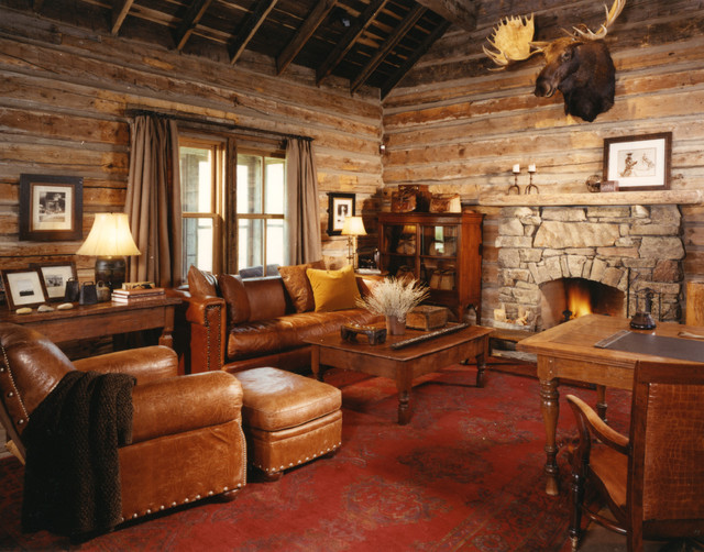 example of a mountain style carpeted and red floor family room design in other with brown