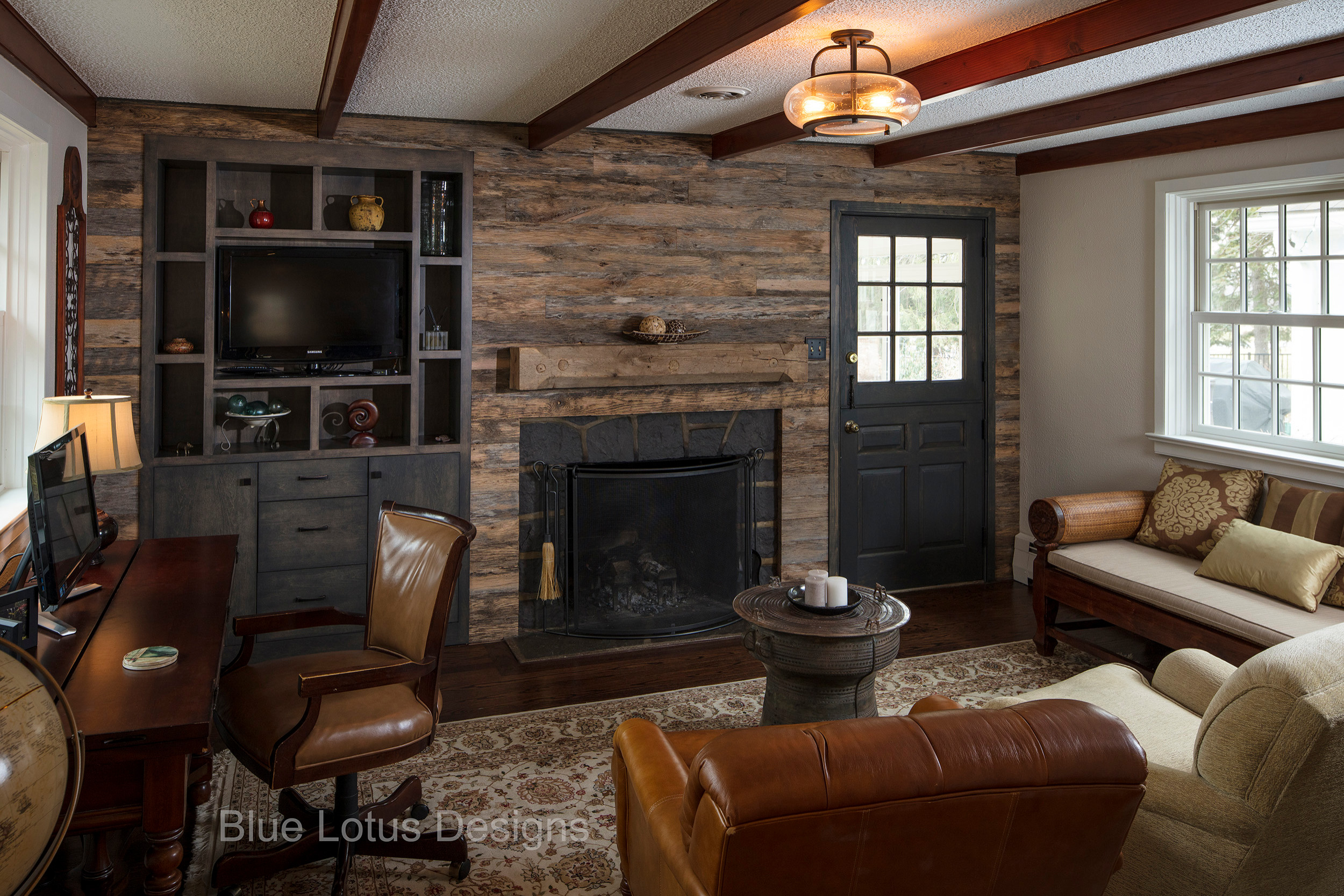 Rustic Family Room with Built-in and Fireplace