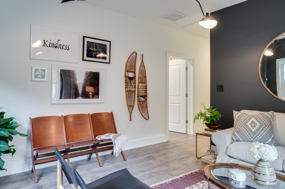 Inspiration for a mid-sized transitional enclosed light wood floor and beige floor family room remodel in Atlanta with black walls, no fireplace and no tv