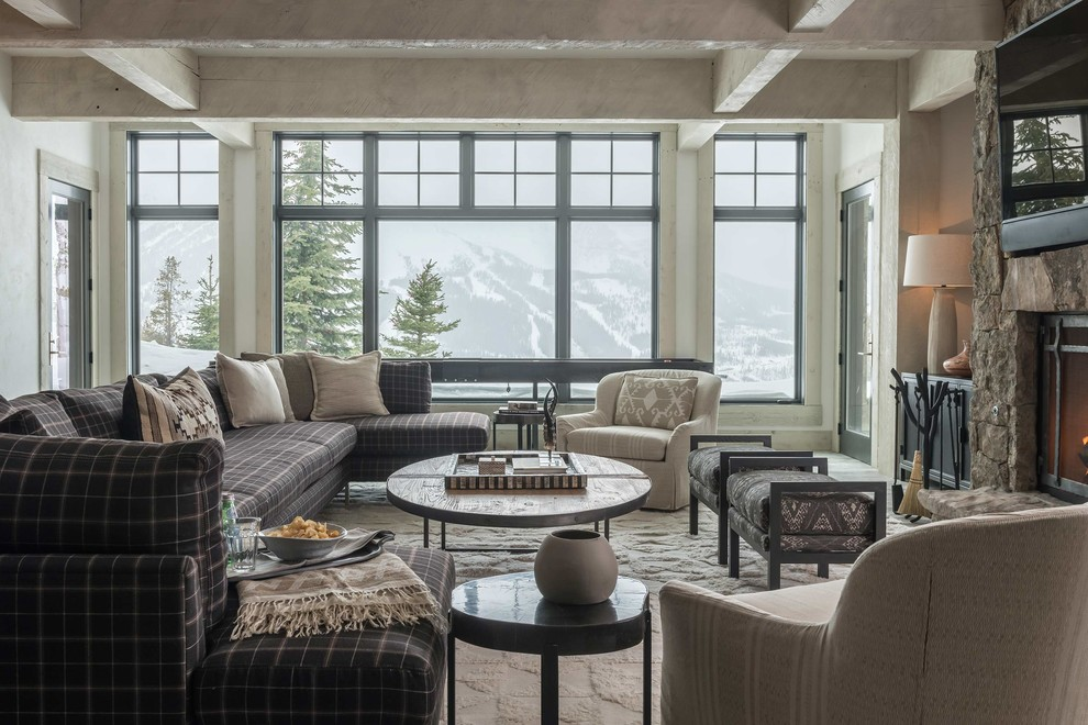Inspiration for a rustic family room remodel in Other with a standard fireplace and a wall-mounted tv