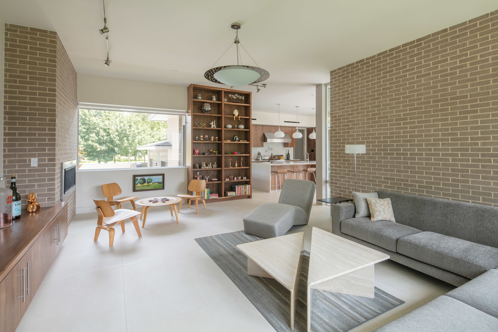 Example of a mid-sized mid-century modern open concept porcelain tile and white floor family room design in Houston with white walls, a ribbon fireplace and a brick fireplace