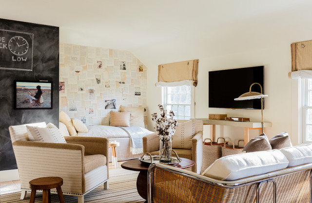 Coastal family room photo in Boston with a wall-mounted tv and beige walls