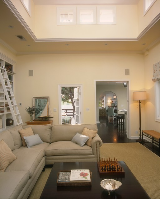 Example of a classic family room design in Los Angeles with yellow walls