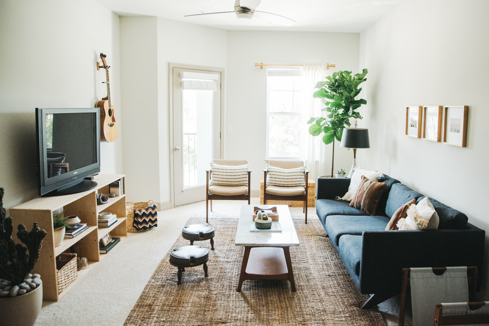 Danish carpeted and beige floor family room photo in Other with white walls and a tv stand